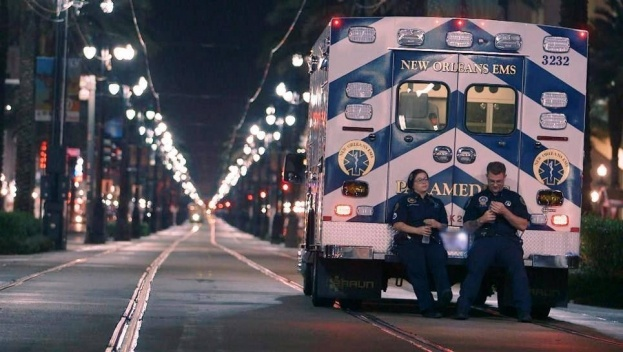 NOLA EMS crew members sit on the back of a #braunambulance on NIGHTWATCH.