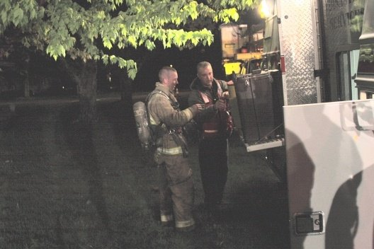Snapshot of firefighters using the beverage station on the old Red Cross ERV.